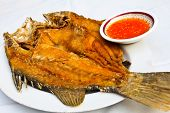 Fried Fish With Thai Spicy Seafood Sauce And Hot And Sour (thai Sauce). poster