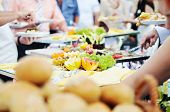 foto of buffet lunch  - people choosing food from table on catering and buffet party on business seminar conference or wedding - JPG