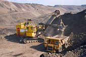 stock photo of earth-mover  - A picture of a big yellow mining truck at worksite - JPG