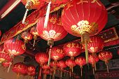 Traditional chinese temple decorated with many red lanterns