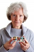 Elderly Woman Holding Pill Dispenser