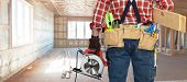Builder handyman with electric saw. poster