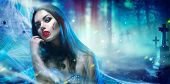 Beautiful Halloween Vampire Woman portrait. Beauty Sexy Vampire Vitch lady with blood on mouth posin poster