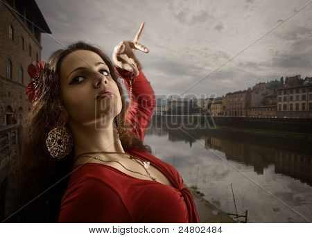 Woman In  Red Dress Dances On The Bank Of The Arno.