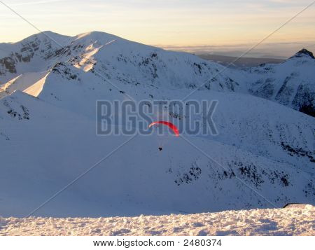 Paraglider Flying Over Mountains.