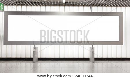 Blank billboard located in underground hall for your advertising