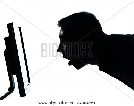 one caucasian business man face silhouette with computer screen display surprised portrait in studio isolated on white background