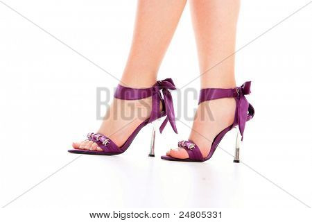 Sexy leg in high heels isolated on white background.