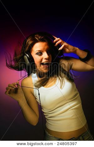 young woman listening music on gradiant background