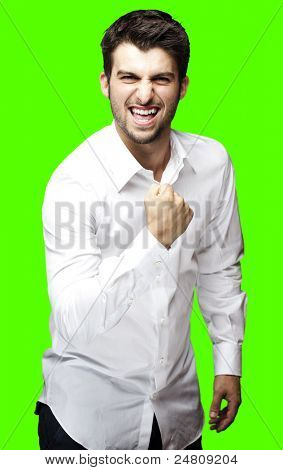 portrait of young man winner against a removable chroma key background