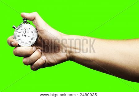 hand pushing a stopwatch button to stop it against a removable chroma key background