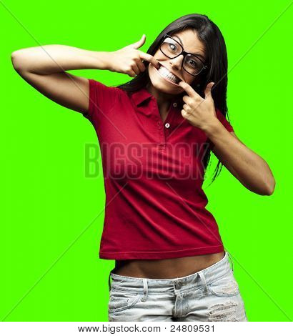portrait of young woman joking against a removable chroma key background