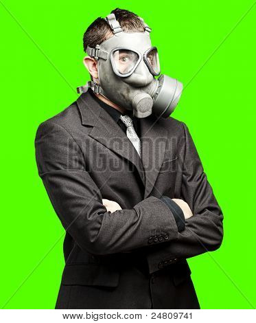portrait of business man wearing gas mask against a removable chroma key background