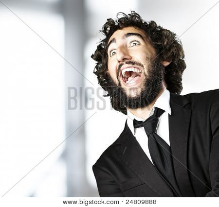 portrait of young man wearing suit laughing indoor