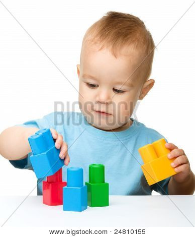 Little Boy Plays With Building Bricks
