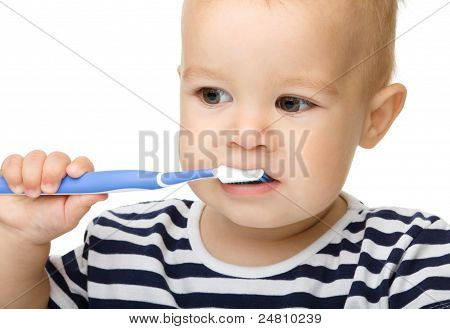Little Boy Is Cleaning Teeth Using Toothbrush