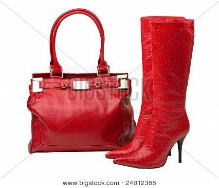 Pair of red boots and female bag, with path