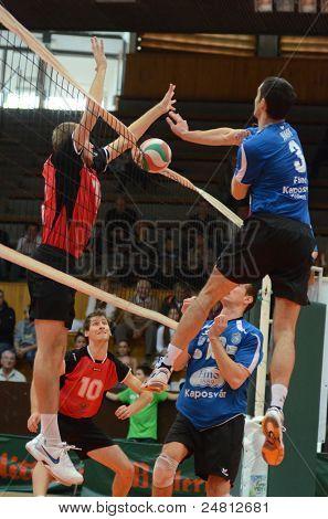 KAPOSVAR, HUNGARY - OCTOBER 29: Jozsef Nagy (R) in action at a Hungarian National Championship volleyball game Kaposvar (blue) vs. Szolnok (red), October 29, 2011 in Kaposvar, Hungary.