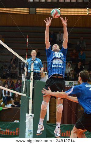 KAPOSVAR, HUNGARY - OCTOBER 29: Tamas Kaszap (10) in action at a Hungarian National Championship volleyball game Kaposvar (blue) vs. Szolnok (red), October 29, 2011 in Kaposvar, Hungary.
