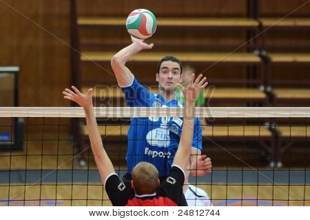 KAPOSVAR, HUNGARY - OCTOBER 29: Jozsef Nagy (in blue) in action at a Hungarian National Championship volleyball game Kaposvar (blue) vs. Szolnok (red), October 29, 2011 in Kaposvar, Hungary.