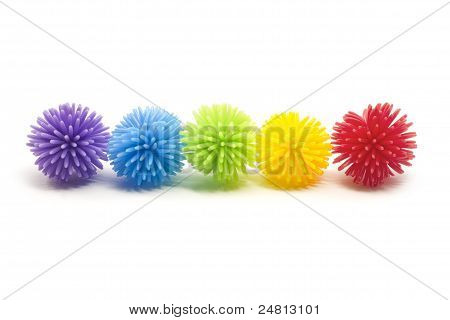 Five Colorful Stess Koosh Balls In A Line