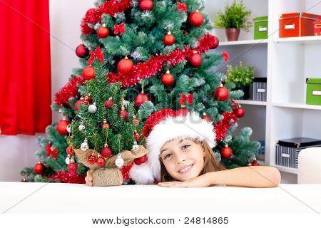 Girl With Small Christmas Tree