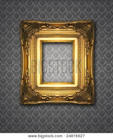 Ornamental gold frame on damask wallpaper