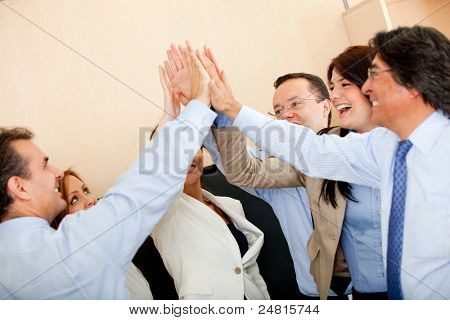 Group of business people giving a high-five