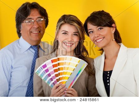 Business people with an interior designer decorating the office