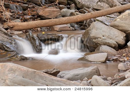stream, rocks and fallen tree