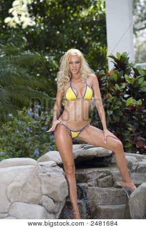 Hot blonde in yellow bikini at the
