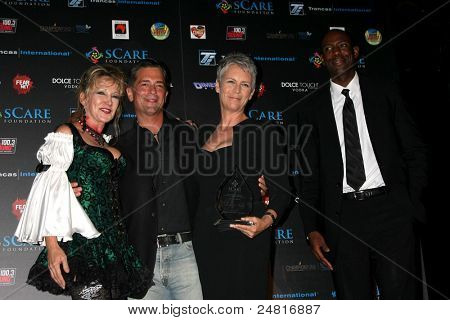 LOS ANGELES - OCT 30:  Donna Keegan, Malek Akkad, Jamie Lee Curtis, Jamie Hall arrive at the sCare Foundation Halloween Launch Benefit at Conga Room - LA Live on October 30, 2011 in Los Angeles, CA