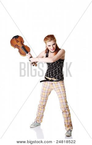 Angry punk girl intending to break her fiddle. Isolated on white.