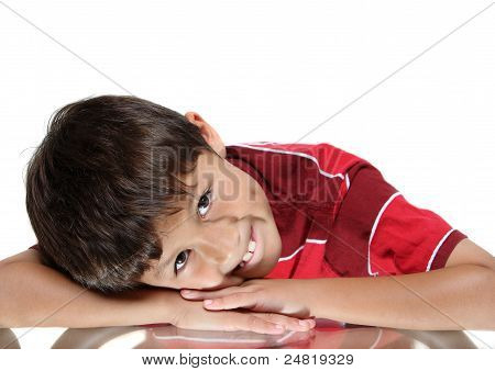 Young Boy Resting Head In Arms