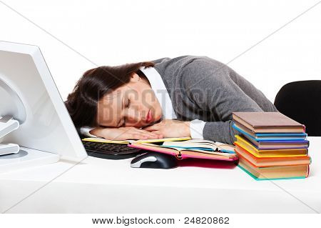 tired student sleeping on her workplace