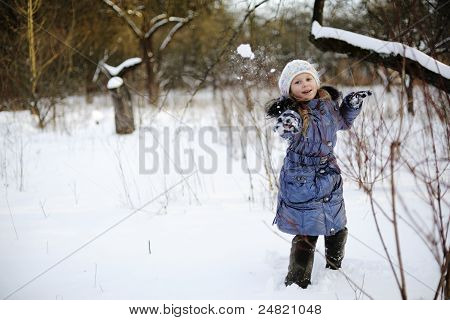 Little Girl Playing Snowballs