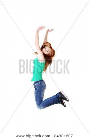 Teen caucasian student jumping and raising hands in the air. Isolated on white background.