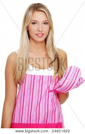Beautiful happy young blond woman wearing kitchen apron, isolated on white