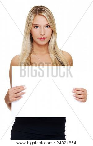 Beautiful young blond business woman is holding blank whiteboard sign. Isolated on white background.