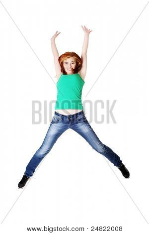 Teen caucasian student jumping and raising hands in the air. Isolated on white.
