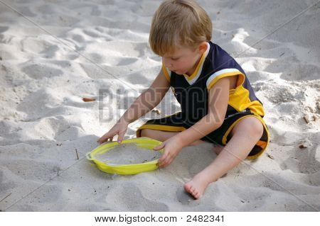 Toddler In The Sand