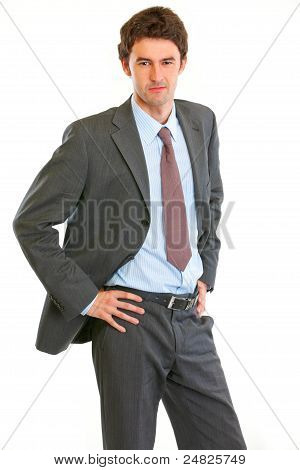 Angry Modern Businessman With Hand On Hips