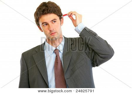 Modern Businessman Trying To Plug Usb Flash In Head