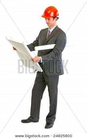 Modern Architect Checking Architectural Plans
