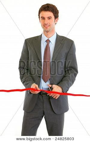 Lächelnd modernen Geschäftsmann schneiden Rote Schleife