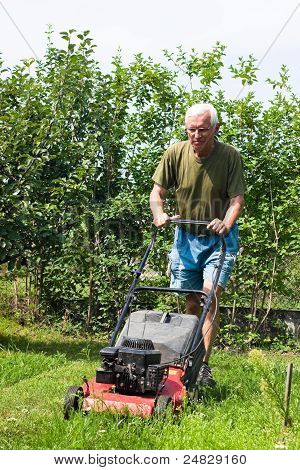 Senior Man Mowing Lawn
