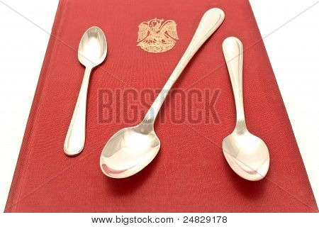 Threes Silver Spoons On Red