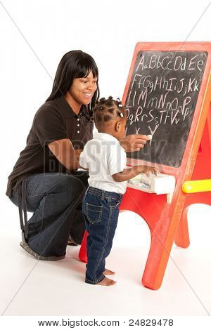 3 Year Old African American Girl and Mom Standing in font of Blackboard