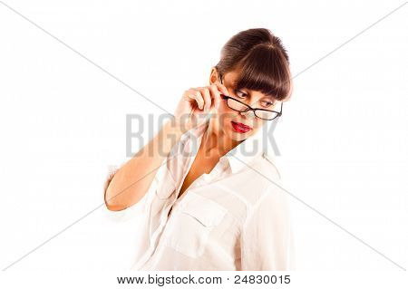 Beautiful young business woman in white, tilting glasses and red lips looking down