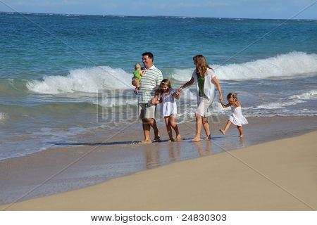Family walking at beach together